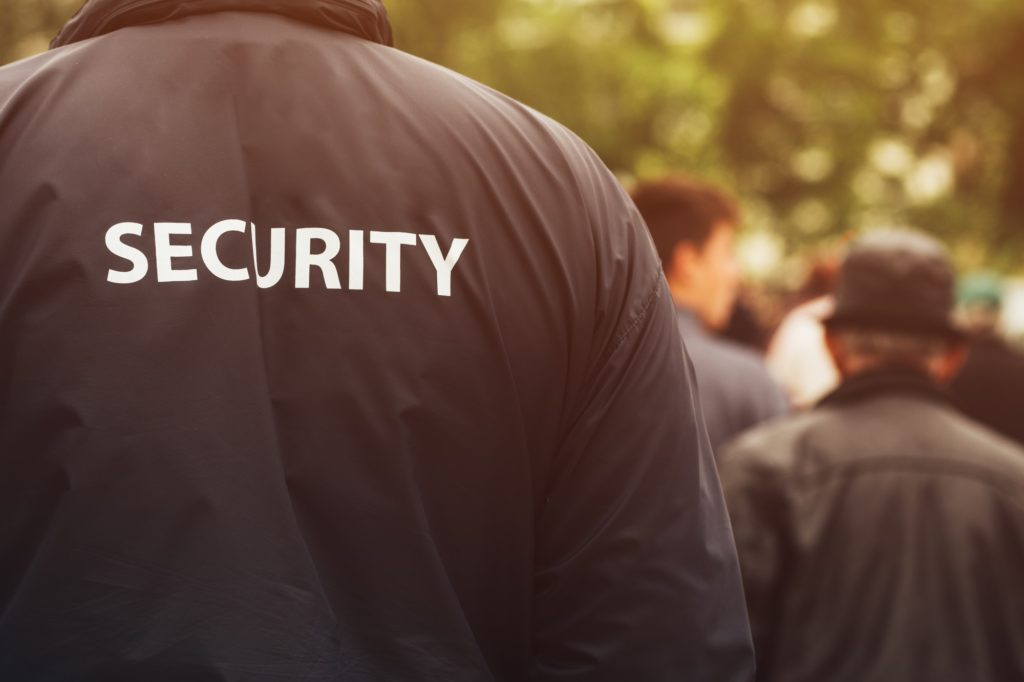 Gate guard security officer on public event